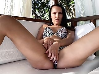 Hot Dark Haired Masturbates And Gets An Orgasm On The Beach